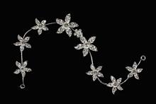 гибкий гребень серебристого цвета с мелкими стразовыми цветочками, фото