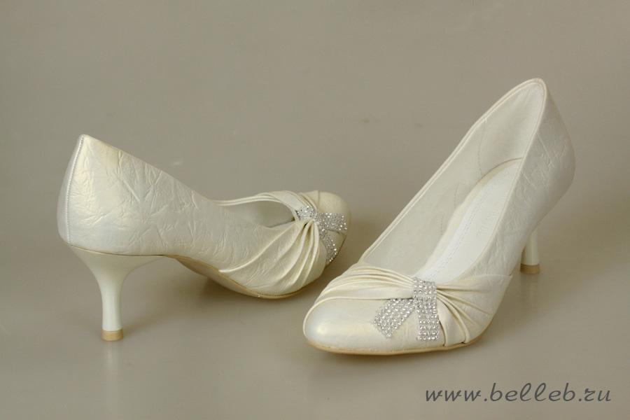 свадебные туфли белого цвета большого